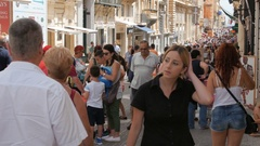 MALTA CAPITAL VALLETTA CITY CENTRE, PEDESTRIAN STREET - JULY 2016: Many tourist Stock Footage