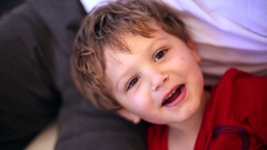 Handsome 4 year old boy smiling and starring to camera  Cute adorable  Stock Footage