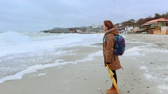 Girl looking at the stormy sea Stock Footage
