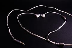 Headphones Earphones White Heart Shape Symbol Metaphor Love Music Black Bac.. Stock Photos