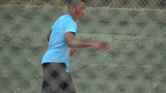 A young man basketball player dribbling before passing the ball to a teammate, s Stock Footage