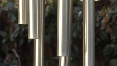 A light breeze stirs a wind chime of metal pipes. Stock Footage