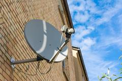 Orange Brick Blue Sky Exterior Building Satellite Dish Broken Technology Cabl Stock Photos