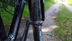 Mountainbike pedals click in detail with one shoe and riding along a track Stock Footage