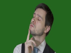 Young man is thinking and have an idea on chroma key background. Slow motion. Stock Footage