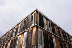 Wood Log Panel Building Rough Brown Shades Burnt Look Exterior Architecture.. Stock Photos