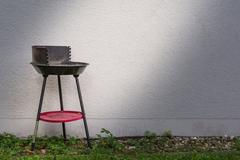 Small Charcoal Grill Spotlight Grey Architecture Exterior Wall Concrete Bac.. Stock Photos