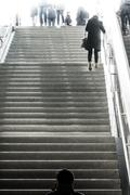 Woman Ascending Going Up Staircase Bright White Lights Monochrome Street Mo.. Stock Photos