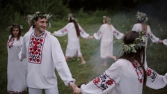 Midsummer. Young people in Slavic clothes revolve around a fire in the Midsummer Stock Footage