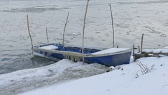 Winter scene with boat at river Stock Footage