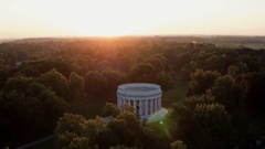 SUNRISE WITH HARDING MEMORIAL IN VIEW - LENS FLAIR Stock Footage