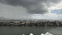 Cloudy weather italian city sea rocks slow motion Stock Footage