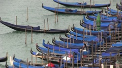 Many Gondoliere in the port of Venice in Italy Stock Footage
