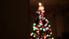 Family Christmas Tree with Blurred Lights Slow Dolly Shot, 4K Stock Footage