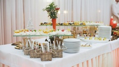 Beautifully decorated catering banquet table with different food snacks and Stock Footage