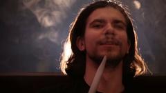 Hairy man smokes shisha closeup Stock Footage
