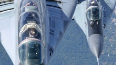 Pilot of Fighter Jet Takes Pictures in Flight. MiG29 4K UltraHD Stock Footage