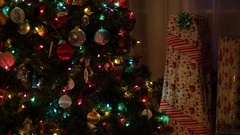 Christmas with Gifts Under Tree a Guitar Wrapped Up Dolly Shot, 4K Stock Footage