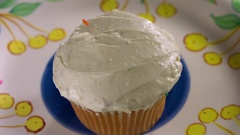 Hundreds and thousands being sprinkled on cupcake in slow motion Stock Footage