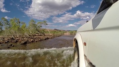 4x4 vehicle crossing Pentecost River along Gibb River Road Stock Footage
