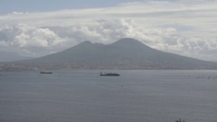 Vezuvio volcano in slow motion across the sea with boat Stock Footage