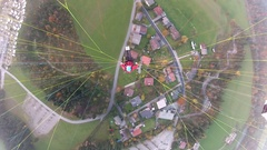 A young man paragliding over a European landscape. Stock Footage