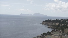 Italian mountains with sea and clouds  with beach in Naples Stock Footage