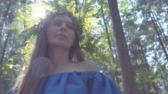 The girl in the image of a forest nymph in a blue dress and a wreath of fern Stock Footage