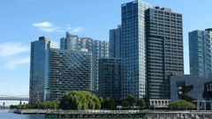 Buildings on East River in Long Island City, New York Stock Footage
