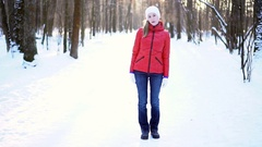Attractive young woman dancing funny and silly in a winter park, having fun Arkistovideo