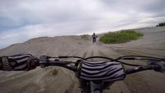 Motocross pov sprayed with sand in berm Stock Footage