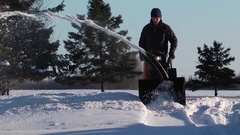 Snowblower gets closer and closer Stock Footage