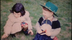 Cute kids play on the backyard grass at home, 3904 vintage film home movie Stock Footage