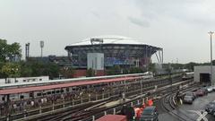 Establishing shot daytime DX of Arthur Ashe Stadium during the US Open Tennis Stock Footage
