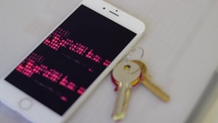 CELL PHONE GETTING HACKED DOWNLOADING FILES HOUSE KEYS NEXT TO IT MOBILE HACK Stock Footage