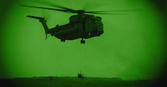 Night vision footage of a CH-53 stallion helicopter during a rescue mission Stock Footage