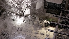 Aerial view of small parterre on cold blizzard snow winter night Stock Footage