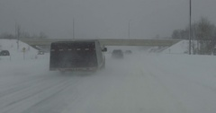 POV dashcam driving in heavy snow whiteout and blizzard in squalls in Muskoka Stock Footage