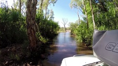 4x4 vehicle crossing River along Gibb River Road Stock Footage