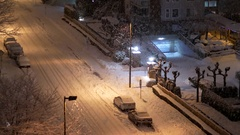 Aerial view of four way traffic intersection covered with snow Stock Footage