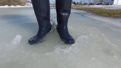 Rubber boots dancing and splashing in slush 4k Stock Footage