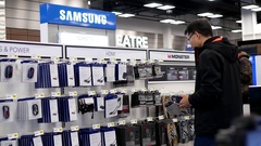 Motion of people buying home theatre accessories inside Best buy store Stock Footage