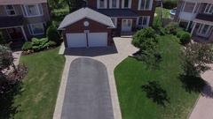 Real estate aerial home reveal in beautiful neighbourhood 4k Stock Footage