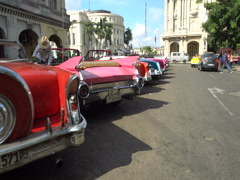 Movement along the row of bright colorful retro cars in parking at Havana Stock Footage