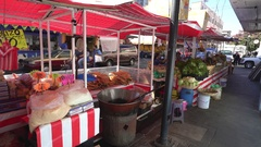 Mexico City street view. Vendor stand close to the market Stock Footage