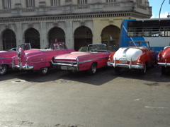 Movement along bright colorful retro cars in parking at Havana Stock Footage