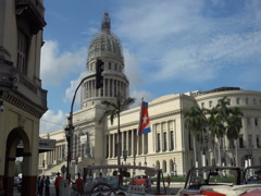 Cuban flag is fluttering on a background of the Capitol in Havana Stock Footage