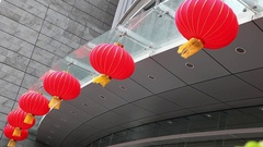 Chinese new year lanterns lamps waving on the wind in Shanghai, China Stock Footage