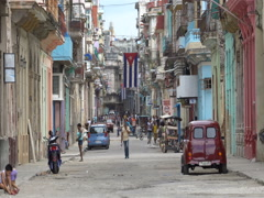 Cuban flag is fluttering on air in the high floor of building at Havana s Stock Footage