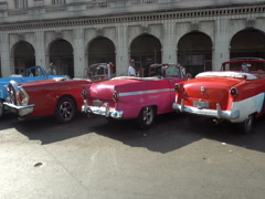 Movement along bright colorful retro cars in parking lot at Havana Stock Footage